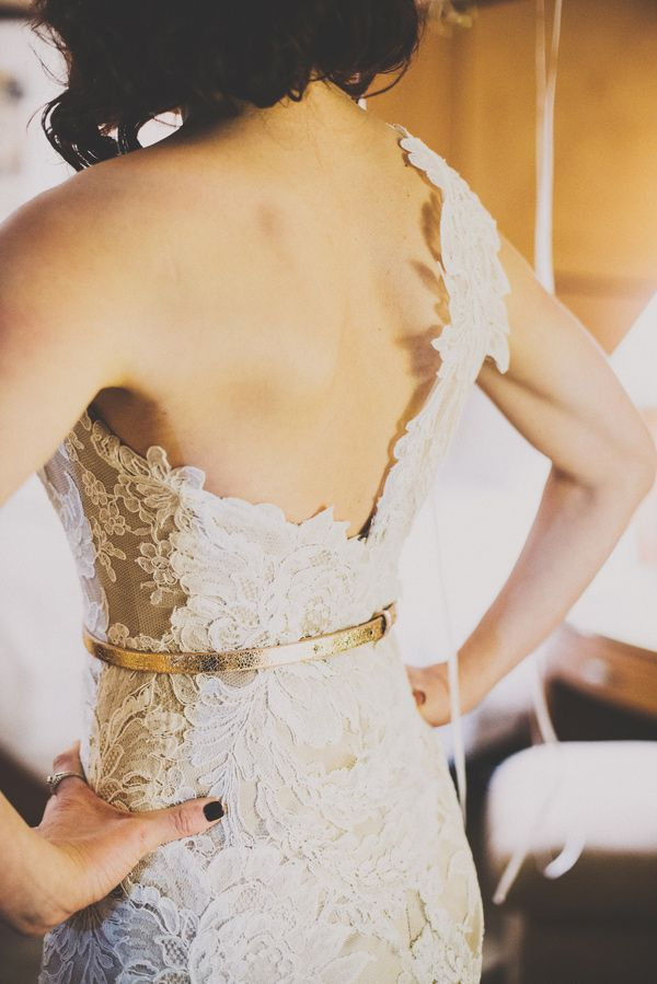 one-shouldered wedding gown, photo by Suzuran Photography http://ruffledblog.com/new-years-eve-cleveland-wedding #weddingdress #lace #weddingfashion