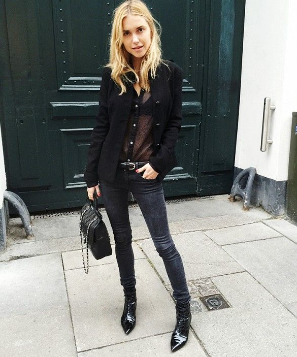 Pernille Teisbaek of Look de Pernille wears a sexy sheer blouse, black jeans, and patent leather boots.