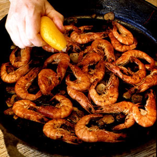 All over Spain and Portugal, meat and seafood are cooked on large, flat iron griddles, or planchas; cast-iron skillets are a perfect substitute.