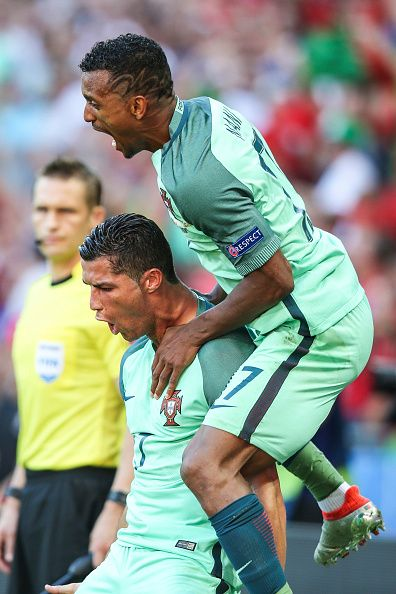 #EURO2016 - Cristiano Ronaldo of Portugal celebrates with teammate Nani after scoring during the UEFA EURO 2016 Group F match between Hungary and Portugal at...