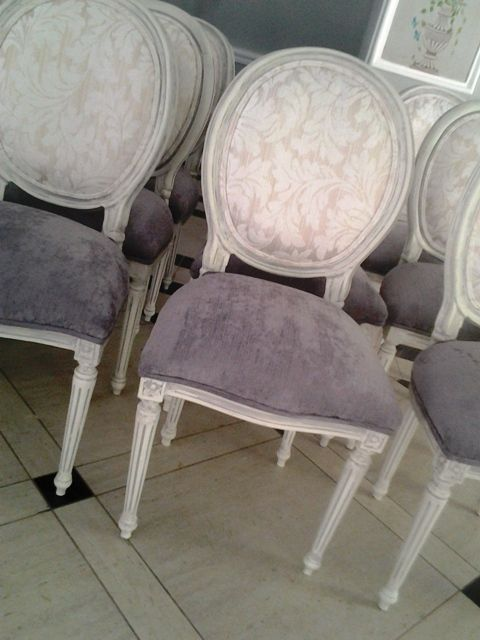 Vintage dining chairs: 50 chairs painted off-white and aged with grey and cream upholstery for a wedding venue.