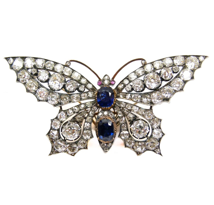 19th century diamond and sapphire tremblant butterfly brooch, c.1880  , the wings set with lines of cushion cut diamonds, the principal stones forming the markings, cushion cut sapphires forming the thorax and abdomen, cabochon ruby eyes and diamond highlights to the head and antennae, open set in silver and gold
