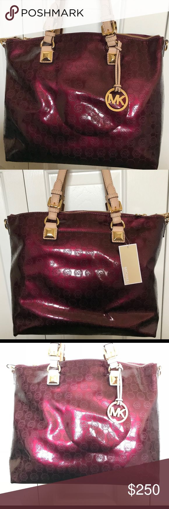 NWT authentic Michael Kors red/cranberry handbag New with tags purchased from Macy's authentic Michael Kors cranberry red handbag.  Can be used over the shoulder or cross body.  Bag comes with long strap.  Please look at the pictures, bag has a crease from the handle do to storage.   Comes with dustbag   Please ask all questions before offer. Michael Kors Bags Shoulder Bags