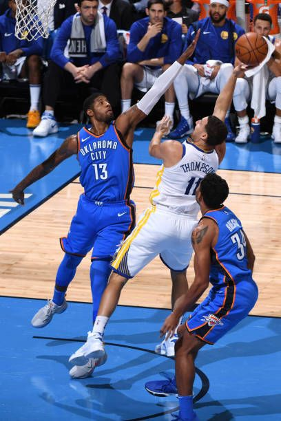 Klay Thompson of the Golden State Warriors handles the ball against the Oklahoma City Thunder during the game at the Chesapeake Energy Arena on...