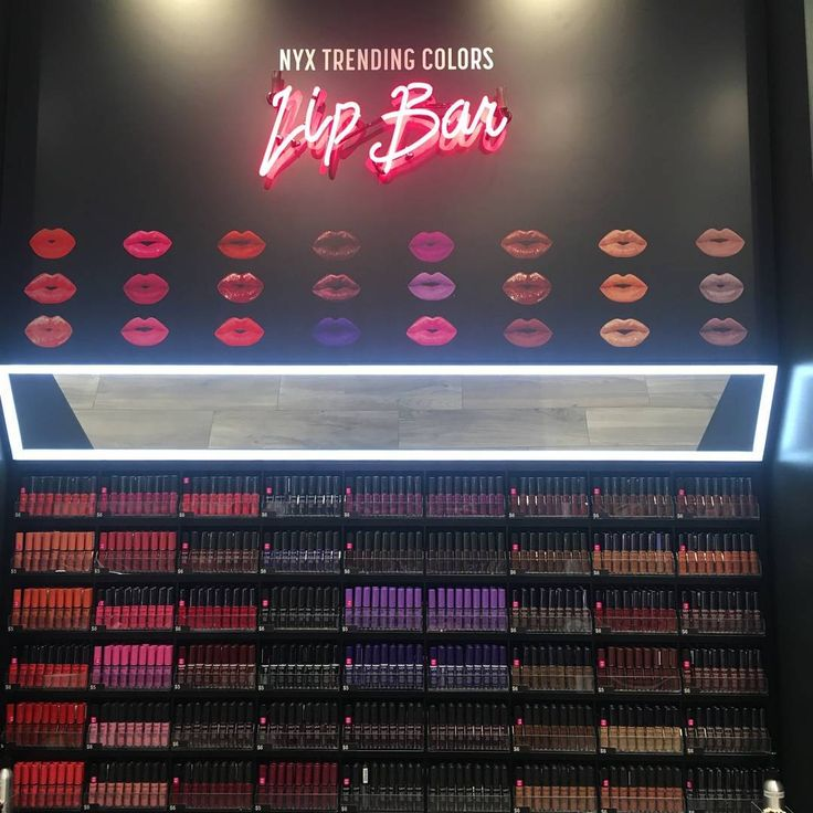 The stunning lip bar at the NYX Cosmetics store! All of the most gorgeous lipstick colors all in one place!