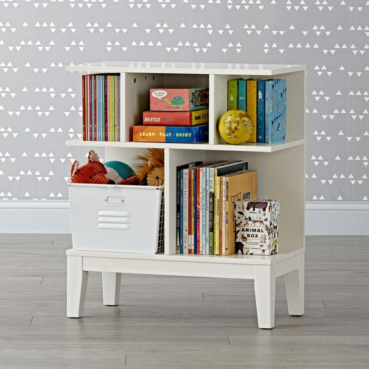 Shop Sprout Small White Bookcase.  Our Sprout Small Bookcase is unique, modern and sized just right for compact spaces.  It has a variety of shelves and compartments, so it can store everything from books and toys to decor.