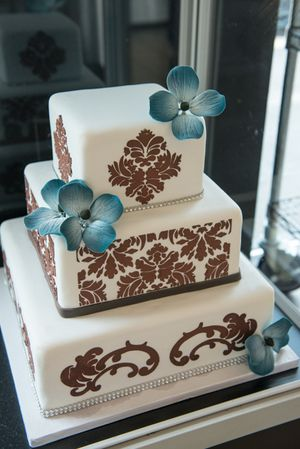 Blue And Red Flowers On An Oakmont Bakery Wedding Cake