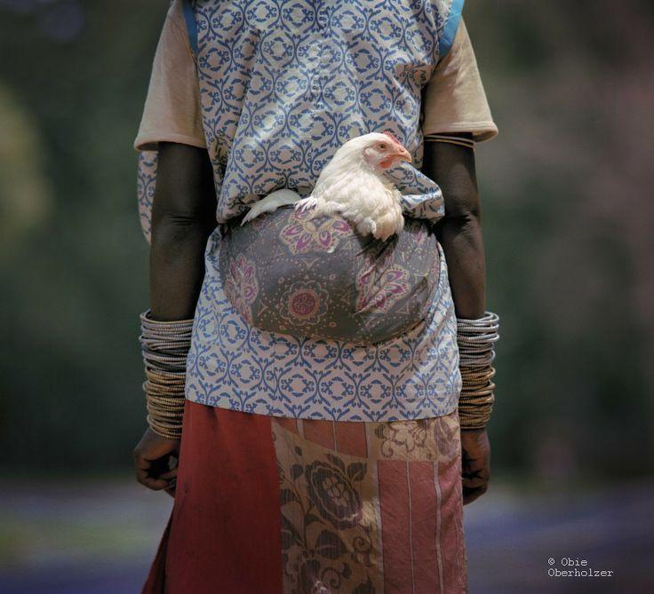 Zulu woman on her way to market b y Obie Oberholzer