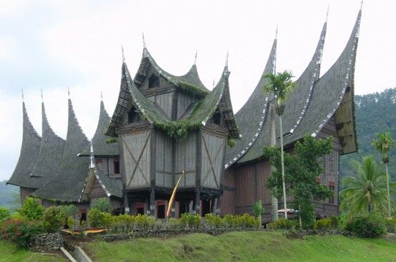 """Rumah Gadang """"big house"""", example of the traditional homes of the Minangkabau, a matrilineal people of West Sumatra, Indonesia. A rumah gadang serves as a residence, a hall for family meetings, and for ceremonial activities. The rumah gadang is owned by the women of the family who live there; ownership is passed from mother to daughter."""