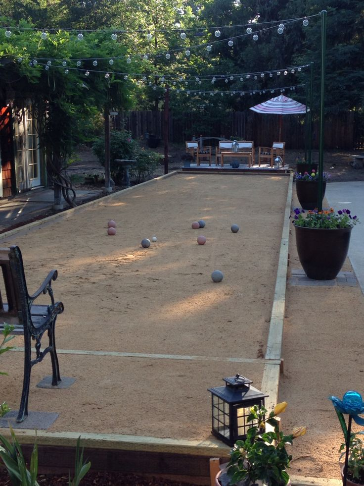 Our bocci court! Loved using large planted pots to anchor the poles for stringing the lights!