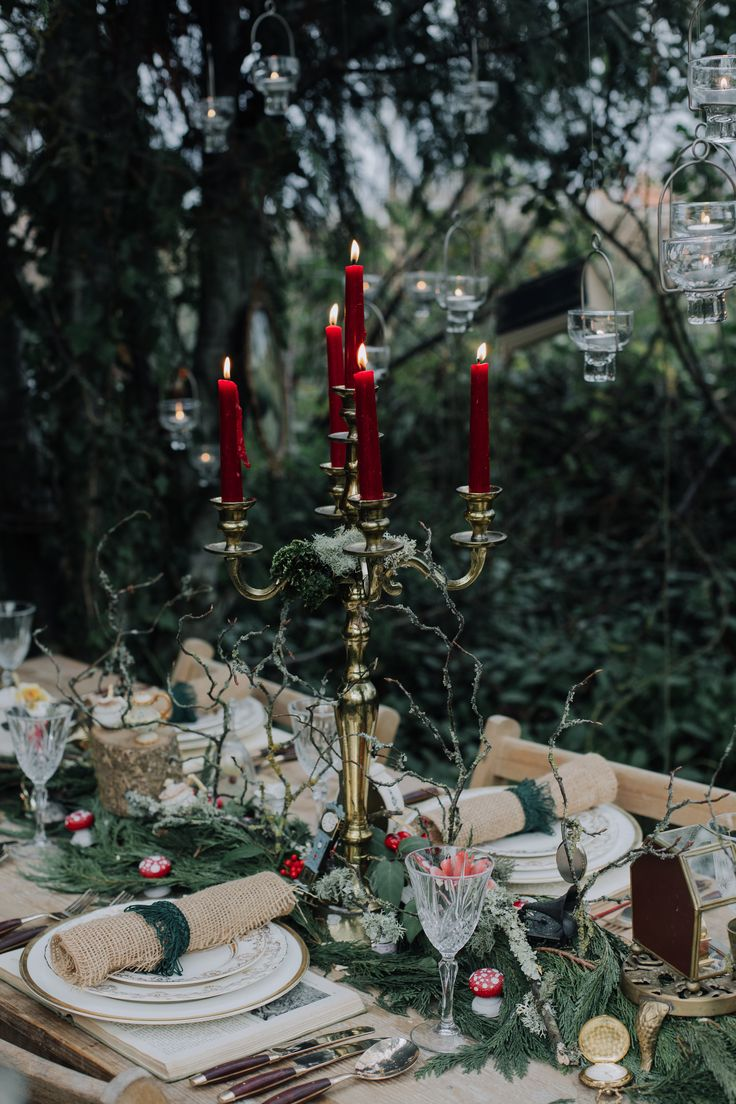Enchanted forest table set up with gold candelabra