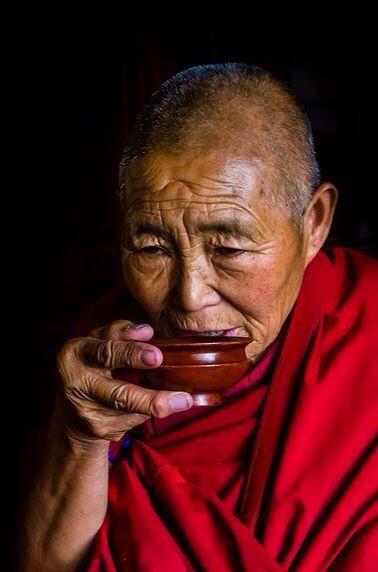 Tibet - nun drinking tea...