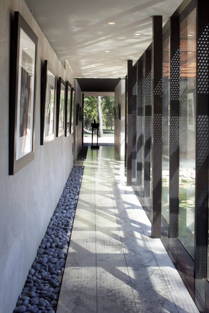Hallway with glass walls, windows to yard/courtyard/backyard