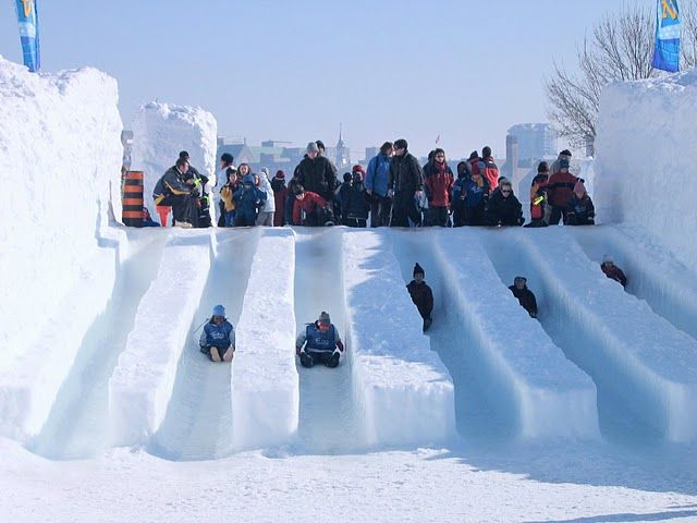 Ice slides at Snowflake Kingdom in Jacques Cartier park during Winterlude, Ottawa, Canada. For more information on Winterlude visit http://www.ottawatourism.ca/en/visitors/top-attractions/winterlude