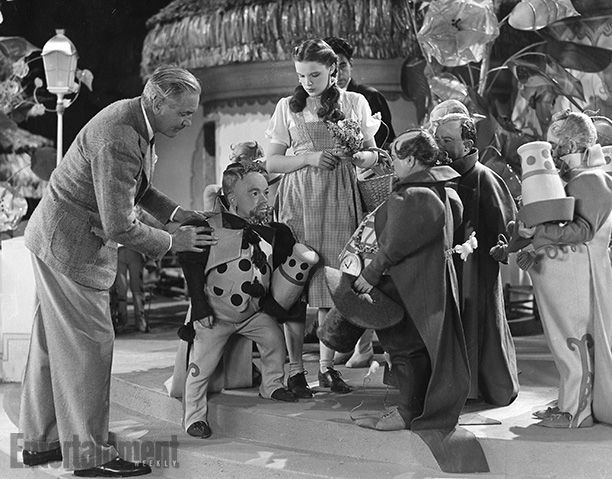 The Wizard of Oz | Fleming with actors Billy Curtis (left) and Charlie Becker (right). Stories of randy Munchkinland behavior, like the anec...