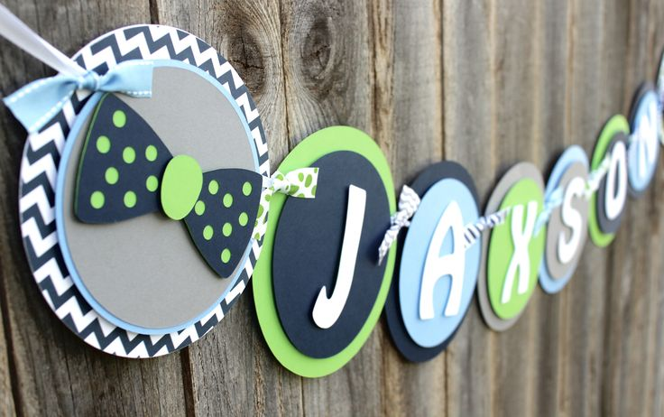 "This banner absolutely screams ""BOY""! The gorgeous combination of colors and patterns make this banner a must have to welcome your little man into the world. - Colors: navy, gray, light blue, lime gre"