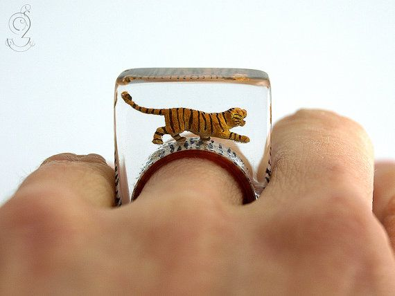 EYE OF THE TIGER... An adventurous, handmade unique for everyday safari. On a copper-colored ring with tiger pattern sneaks Shalima, the black-and-brown striped plastic mini-tiger. The ring is very light and despite of the size extremely good to wear. Moreover it is a hand charmer and always an eye-catcher.   SIZE/DIMENSIONS/WEIGHT This ring will be produced suitable for you (I need about three weeks for the production). Please specify your ring size (you can measure the inner diame...