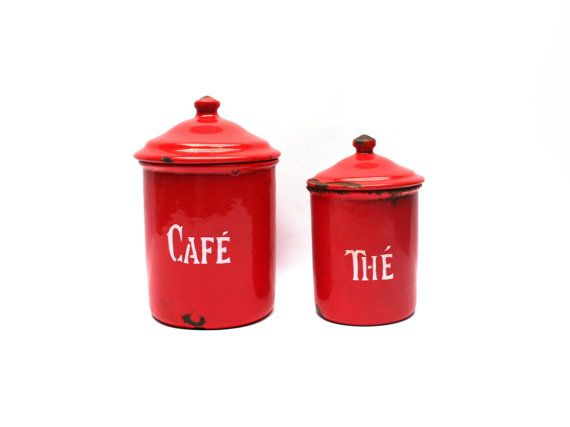 Red enamel canisters from France, circa 1940s.