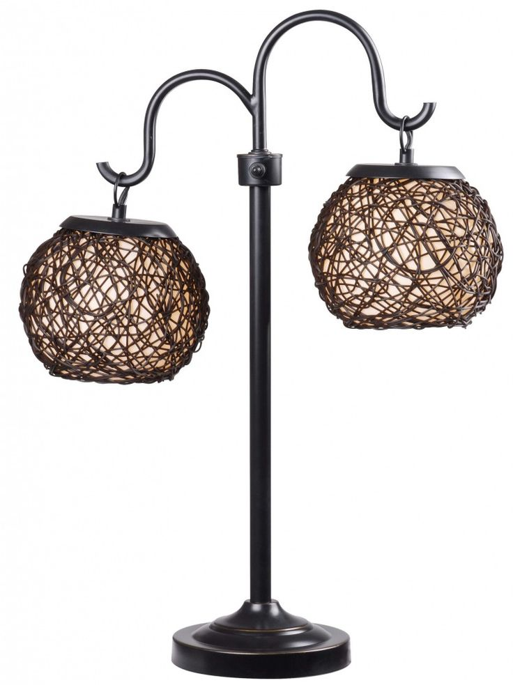 Castillo Outdoor Table Lamp. Twin rounded lanterns shine suspended from graceful curved arms. Castillo's woven shade design is artful and tactile with a Mediterranean flavor.