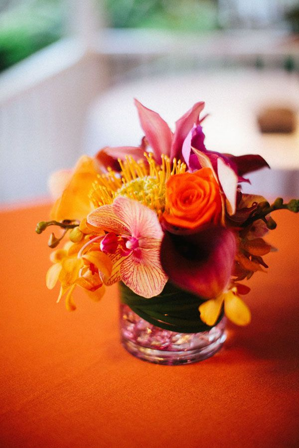 Kauai Destination Wedding - vibrant colored centerpieces, love.