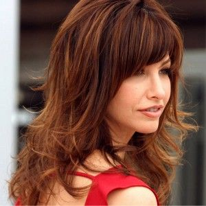 Pretty reddish colored hair for older woman's hairstyle, with heavy bangs and