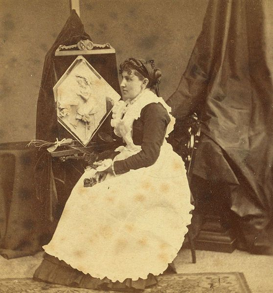 Caroline S. Brooks and her sculpture in butter during a public exhibition at Amory Hall, Boston, USA, in 1877