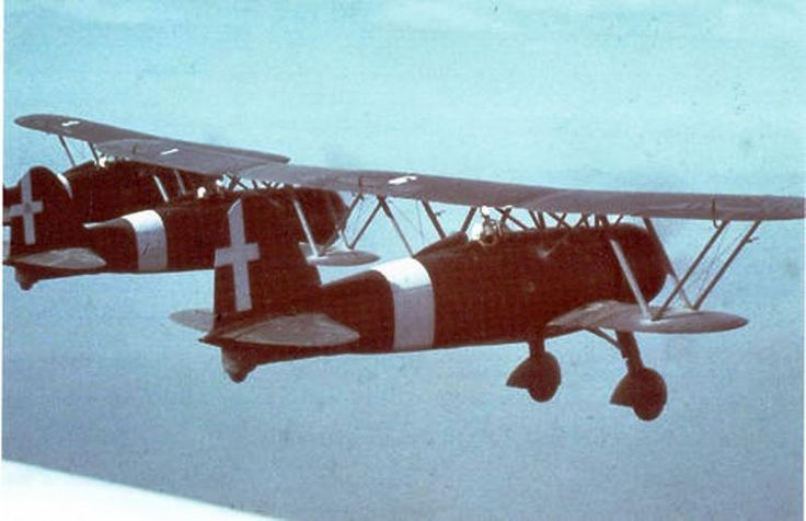 "Fiat CR.42's flying formation, unit and location unknown, 1941 or 1942. The Fiat biplane – the name ""Falco"" (Hawk) was suggested by Air Ministry for propaganda's purposes, but never adopted on the official documents – revealed itself an authentic multipurpose aircraft. In effect in the course of events the CR.42 was employed for many task: interceptor fighter, night fighter, fighter bomber, counter-insurgency, night harassing (by the Germans), glider towing, trainer, liaison (with…"