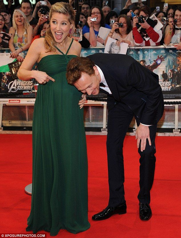 Welcoming their baby: Elsa joked around on the red carpet as she gleefully showed off her bump to Chjris' co-star Tom Hiddleston .. so lvely :3