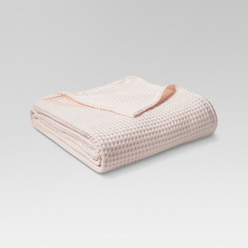 Stay warm on cool nights with the Waffle Weave Blanket from Threshold. This cotton throw blanket works on a bed or the sofa to ward off a chill.