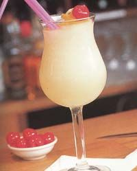 A cocktail of rum, vodka and tequila with coconut cream and lemon juice