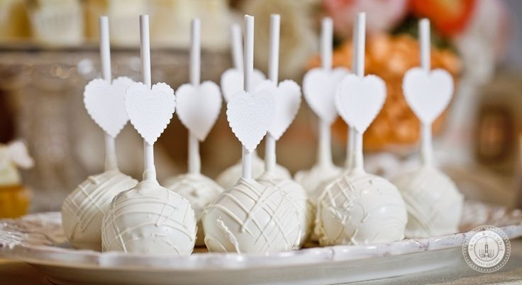 Little paper hearts or silver/grey ribbon tied on cake pop sticks. Cake pops will be propped up on foam block.