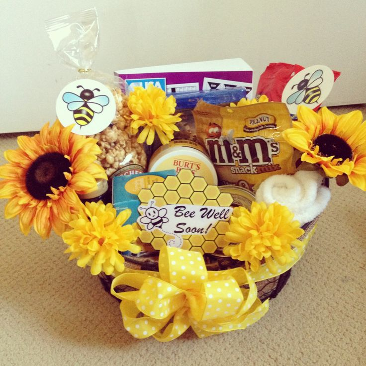 """Bee Well Soon"" gift basket! Get well soon gift Includes: book of brain puzzles, blu-rays of favorite movies, Burt's Bees body butter, organic honey & tea, honey jar filled with ghirardelli chocolates, fluffy socks, caramel corn, M&M sweet & salty mix, Bit o' Honey"