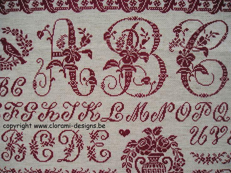Red cross stitch Sampler CloRaMi from Clorami Designs.  www.clorami-designs.be