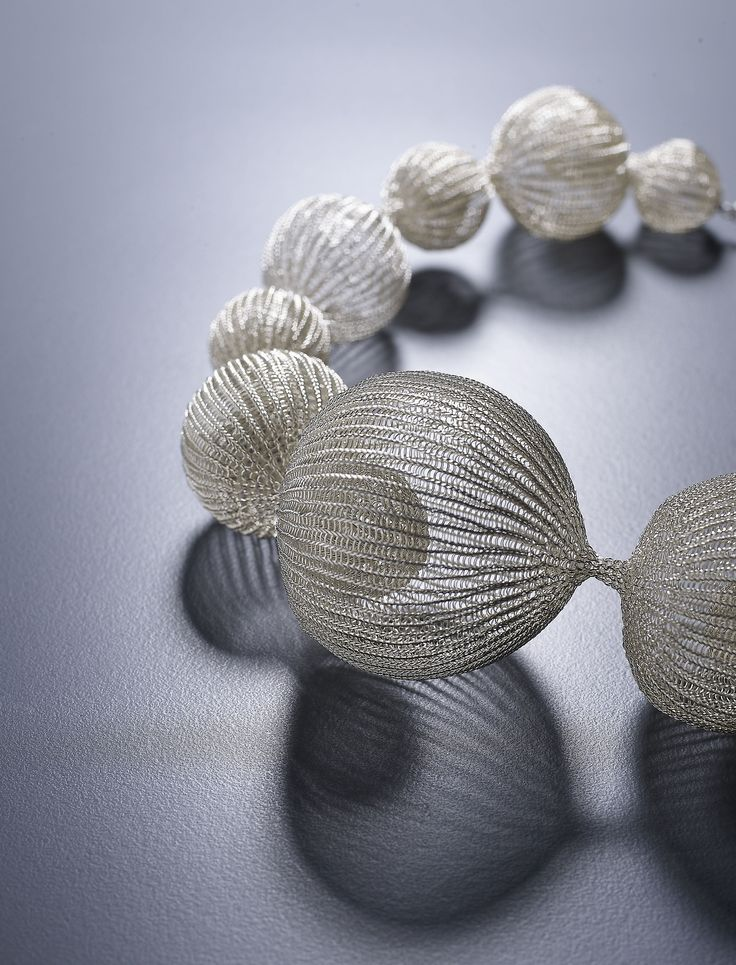 Sculptural 3D pod necklace with delicate knitted wire structure; organic-inspired conceptual jewellery design; art jewelry // Sowon Joo