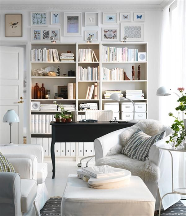 Little reading place...a desk for a laptop, chairs and bookcases appear to be from Ikea. Love the pictures above the shelves.