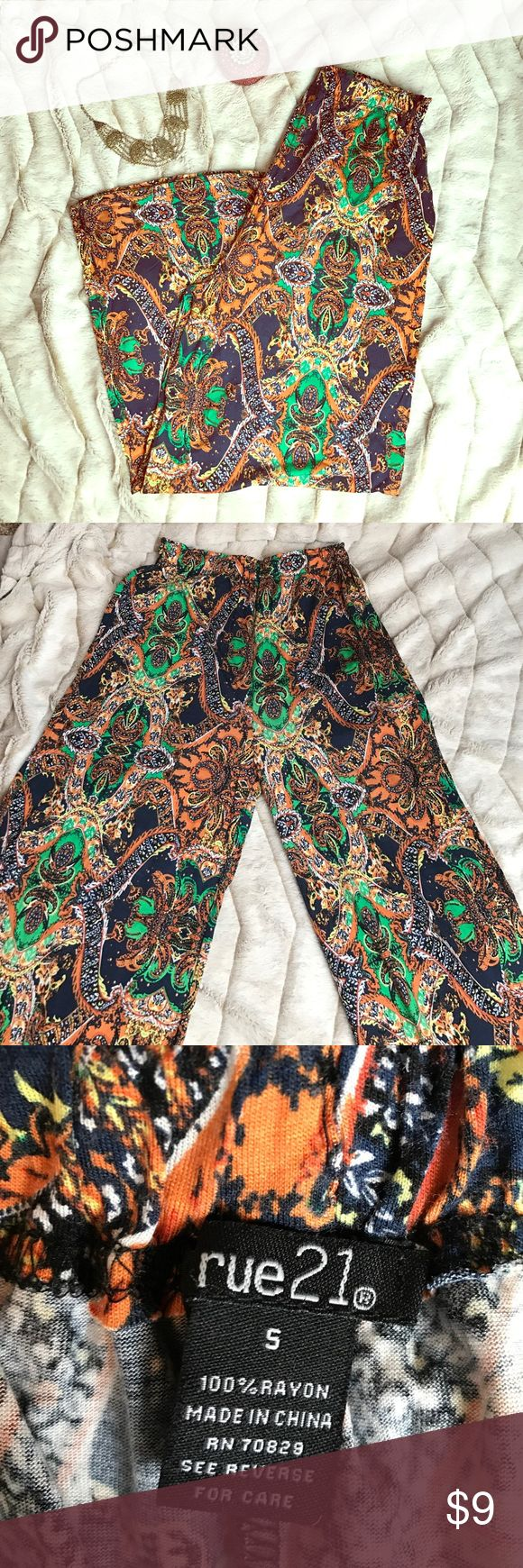 Printed Palazzo Pants Bohemian palazzo pants. Stretchy, comfy, and cute! A little short on me, and I'm 5'5 unless I wear them on my hips then they are floor length. If I wear around my waist they are short. Just a heads up if you're my height or taller!! Rue 21 Pants