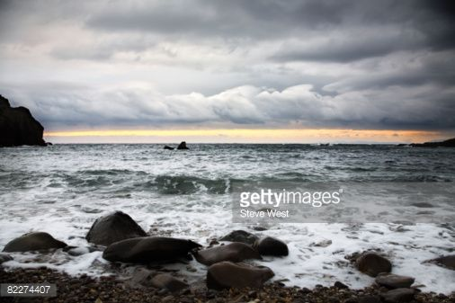 Stock Photo : View of the ocean from small pebble beach.