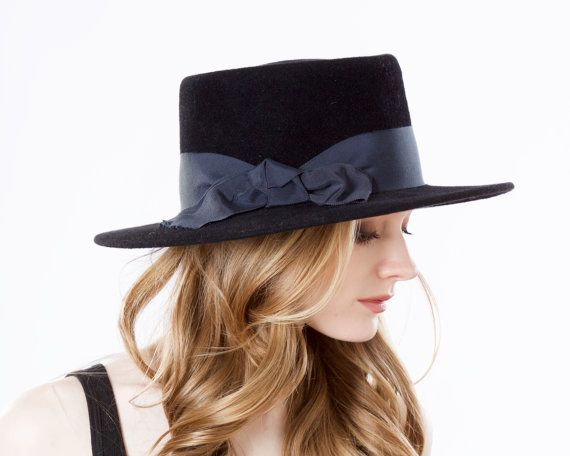 Gaucho Hat- Spanish Hat- Fall Fashion- Winter Accessories- Black Hat- Wide Brim Porkpie Hat- Fall Accessories- Felt Boater Hat- Bolero Hat  Black Gaucho style hat with a just right 3 1/4 inch/9 cm wide brim. I can make this style with a 4.5 inch brim, if you prefer.  Trimmed with a 2 inch wide Midnight/Navy ribbon, finished with a casual style bow.  There is a flexible wire on the edge to maintain shape, and a grosgrain ribbon on the inside for your headsize.  Heidi Gutman Photography Makeup…