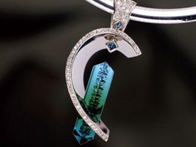 award winning Bernd Munsteiner cut bi-color tourmaline, blue and white diamonds___Custom Necklace Design - Naples, Fort Myers, Southwest Florida - Mark Loren Designs
