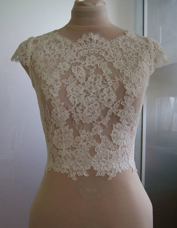 Beautiful wedding bolero.  Color : 1. white 2. ivory  Bolero made of lace. Lace is hand-cut . Bolero in front of a full, fastened at the back. Length to
