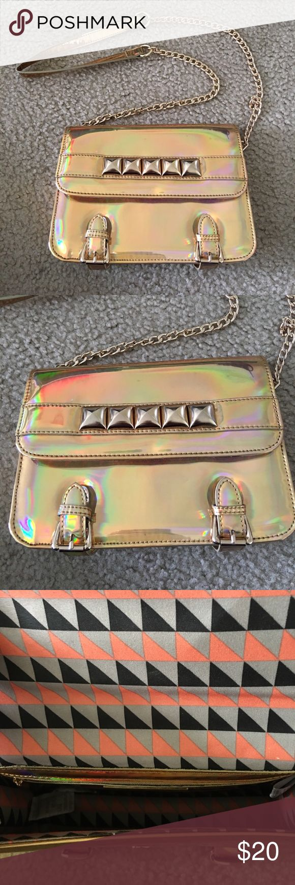 Gold Studded Holographic Crossbody bag Very gently used. Price is negotiable. Features gold hardware. Purchased at DSW shoe warehouse. Street Level Bags Crossbody Bags