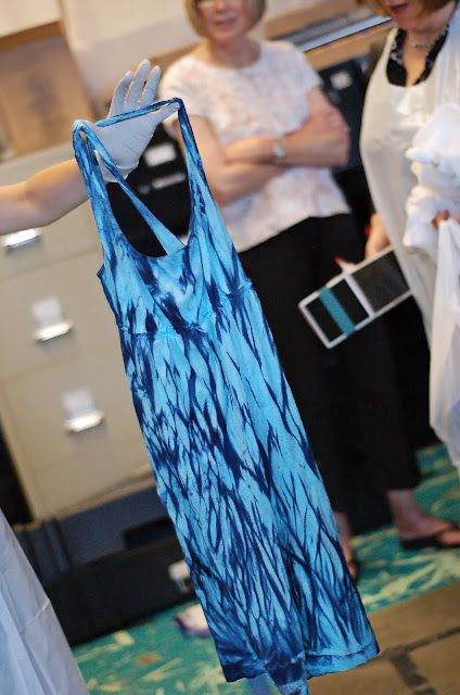 tie dye techniques using a big cardboard tube.  Wrap fabric around tube, scrunch it from the outside in and use spray bottle to spray dye.