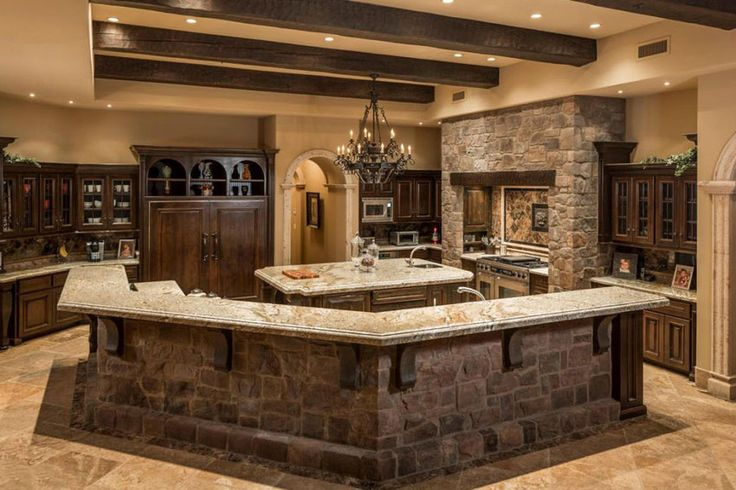 Rustic Mediterranean style kitchen with custom breakfast bar and betularie granite counters