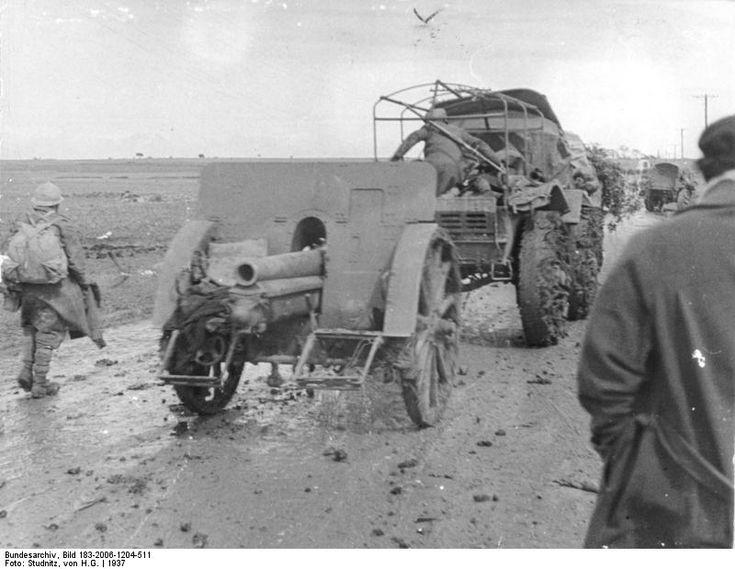 Spain - 1937. - GC - Spanish Nationalist field gun being towed by a truck, the Battle of Guadalajara, Mar 1937