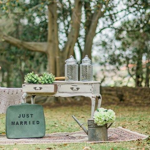 A little drinks station by us #vintage #wedding #sydney #marriage #mr #mrs #bride #groom #innerwest #suitcase #bar #events #prophire #props #prophiresydney #wateringcan #flowers
