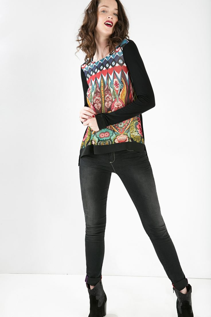 Sometimes it's hard to look smart and chic when the weather gets cold. However, this long sleeved top with chiffon details will keep you covered and keep you chic with its striking pattern and comfortable cut.