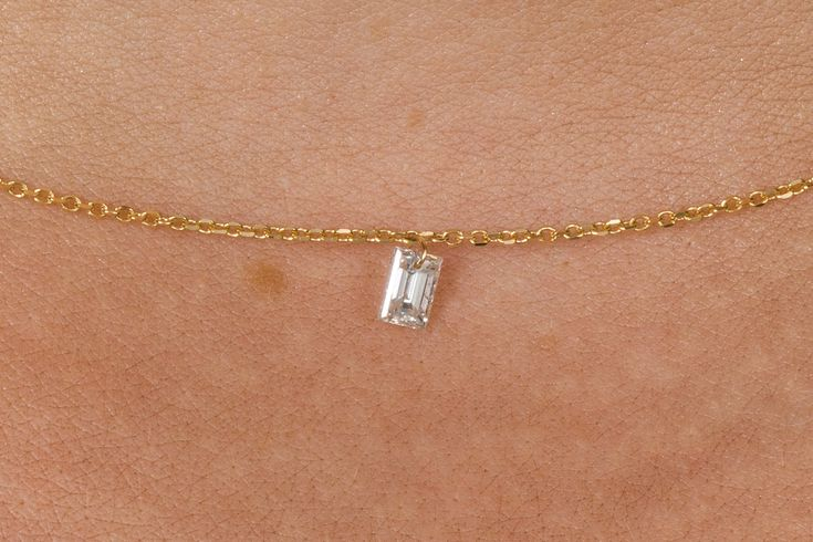 So dainty, a very small baguette cut diamonds 0.195cts hangs from an 18k gold fine trace link chain. Available on www.1stdibs.com