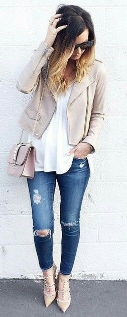 Ripping skinny jeans, white shirt, neutral leather jacket, neutral shoulder bag and lace up flats. Outfiters.com