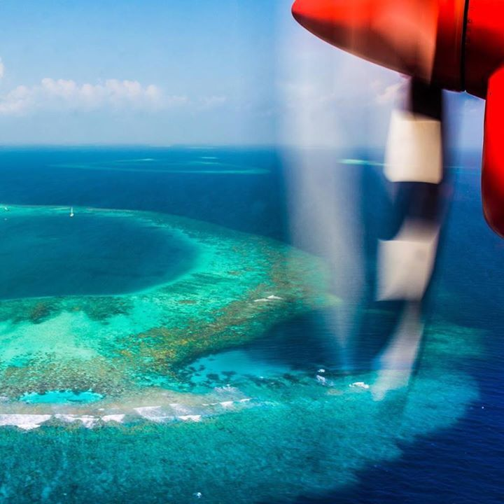 Flying over the Maldives! Known for its beaches blue lagoons and extensive reefs the Maldives is considered to be one of the worlds best learn-to-dive destination!   Where are you going to dive in on your next adventure? Shot by @nodestinations