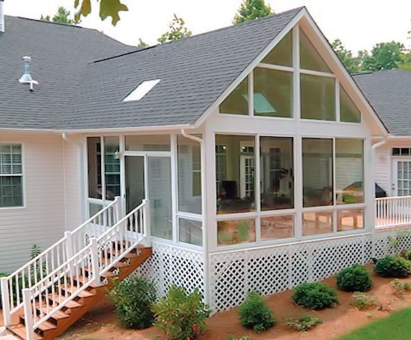 Gabled Roof Covered Deck With Skylights Brick Knee Wall